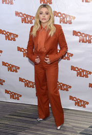 Chloe Grace Moretz opted for a monochromatic rust pantsuit and shirt combo when she attended the New York screening of 'The Miseducation of Cameron Post.'