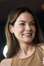 Michelle Monaghan added a dose of elegance with a pair of gemstone drop earrings by Irene Neuwirth.