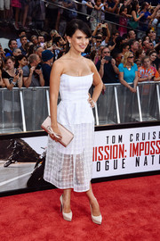 Hilaria Baldwin complemented her frock with pointy white platform pumps.