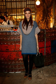 "Margherita Missoni went for a ""mismatched-chic"" look with a pair of leopard-print Mary Janes and a patterned sweater dress."