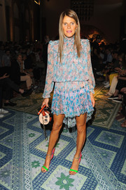 Anna dello Russo sported one of her more conservative looks during the Missoni fashion show--a long-sleeve floral dress by Nina Ricci.