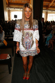 Anna dello Russo was medieval-chic in a Dolce & Gabbana lace and beads dress during the Missoni fashion show.