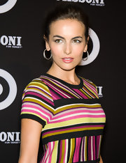 Camilla accessorized her colorful striped dress with simple diamond hoop earrings.