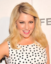 Ari Graynor kept her red carpet look retro-inspired with loose platinum blonde waves.