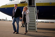 Presidential hopeful Mitt Romney wore a cropped jacket and classic blue jeans while flying into Manchester, NH.