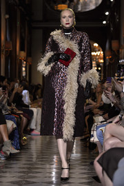Gwendoline Christie looked opulent in a metallic leopard coat with feather trim while walking the Miu Miu Cruise 2019 show.