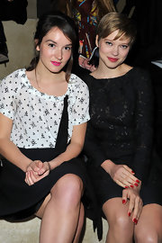 Lea Seydoux attended the Miu Miu fall 2012 runway show wearing glossy cherry red nail polish.