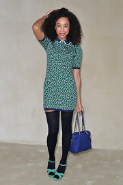 Corinne Bailey Rae wore this darling floral dress with thigh-high socks to the Miu Miu show in Paris.