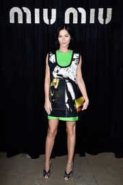 Leigh Lezark attended the Miu Miu fashion show wearing a graphic-print mini dress with neon-green panels.