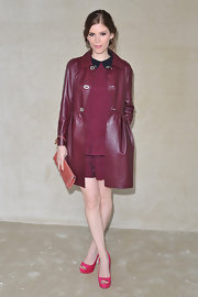 Kate was lovely in burgundy at the Miu Miu show. She accessorized with bright pink peep-toe pumps.