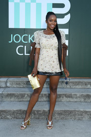 Aja Naomi King styled her look with a pair of bauble-embellished sandals.