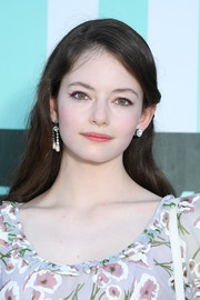 Mackenzie Foy sported a loose, side-parted hairstyle at the Miu Miu Club 2020 event.