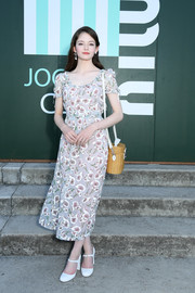 Mackenzie Foy kept it ladylike in a gray floral midi dress at the Miu Miu Club 2020 event.