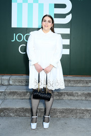 Beanie Feldstein finished off her outfit with a pair of fishnets and platform Mary Janes.