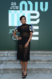 Gabrielle Union flashed some skin in a see-through black crochet dress with rosette-embellished sleeves at the Miu Miu Club 2020 event.