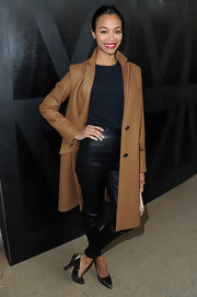 A brown wool coat completed Zoe Saldana's modern and sleek look at Miu Miu's runway show.