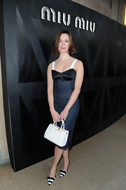 Rebecca Halls striped slingbacks brought a bit of fun to her look at the Miu Miu runway show.