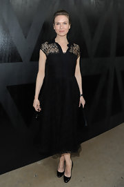 Renee Zellweger opted for a classic A-line dress with full skirt for her look for Paris Fashion Week.