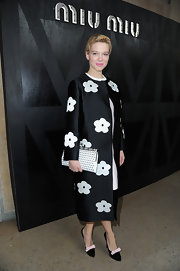 Lea Seydoux was pretty in florals at the Miu Miu fashion show, where she sported this black and white floral coat.
