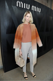 Elena Perminova bundled up in style with this Southwestern ombre wool coat.