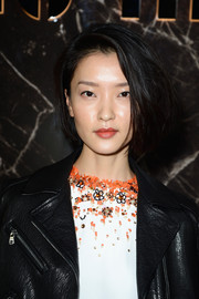 Du Juan contrasted her edgy outfit with a sweet bob when she attended the Miu Miu fashion show.