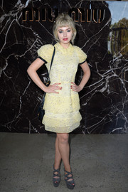 Imogen Poots looked very girly at the Miu Miu fashion show in a textured dress with puffed sleeves and a tiered skirt.