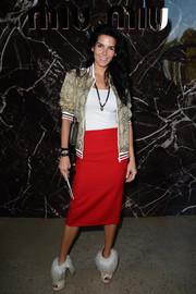 Angie Harmon was sporty-glam in a snakeskin-print track jacket during the Miu Miu fashion show.