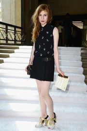 Agathe Bonitzer looked youthful in a sleeveless print blouse and a mini skirt at the Miu