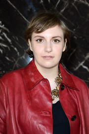 Lena Dunham sported a casual short wavy cut when she attended the Miu Miu fashion show.