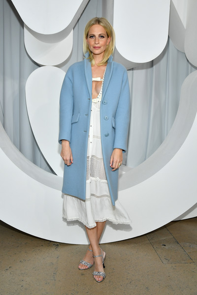 Poppy Delevingne polished off her look with a pair of bedazzled blue sandals.