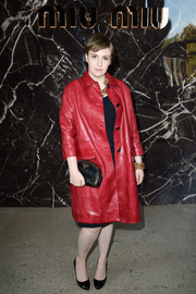 Lena Dunham looked very luxe in a red leather coat during the Miu Miu fashion show.