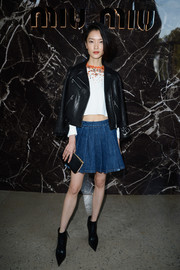 Du Juan looked like an edgy schoolgirl in a pleated denim mini and a leather jacket at the Miu Miu fashion show.