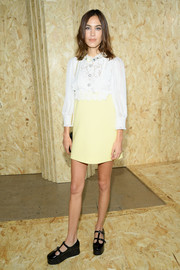 Alexa Chung teamed her dress with black patent platform pumps, also by Miu Miu.