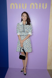 Zhang Ziyi kept it modest in a lace-collar print dress at the Miu Miu fashion show.