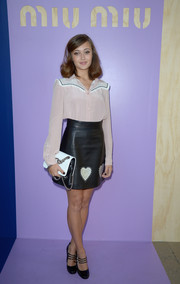Ella Purnell was Western-chic in a pale-pink button-down with a contrast yoke while attending the Miu Miu fashion show.