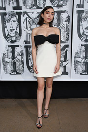 Rowan Blanchard looked coquettish in a strapless white mini dress with an oversized black bow accent at the Miu Miu Fall 2018 show.