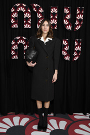 Alexa Chung finished off her ensemble with black platform pumps and matching socks.