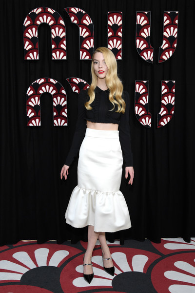 Anya Taylor-Joy flashed her taut abs in a black ruffle crop-top at the Miu Miu Fall 2020 show.