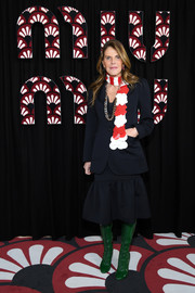 Anna dello Russo went for cool styling with a pair of tall green lace-up boots.