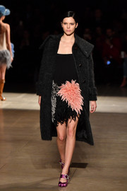 Kendall Jenner was flapper-chic in a cocktail dress with a fluffy fringed skirt at the Miu Miu runway show.