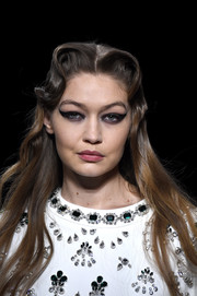 Gigi Hadid looked retro-glam with her winged liner and victory rolls at the Miu Miu Fall 2020 runway show.