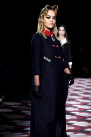 Rita Ora walked the Miu Miu Fall 2020 runway wearing black leather gloves with a navy coat.