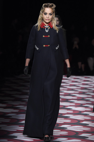 Rita Ora looked classy in a floor-length navy coat with a contrast collar while walking the Miu Miu Fall 2020 runway.