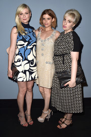 For a touch of edge, Lena Dunham accessorized with a studded black leather clutch.