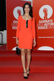 Freida chose a bold shade of red for her red carpet look at the 'Miu Miu Women's Tales' presentation in Venice.
