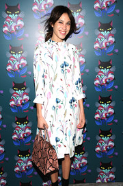 Alexa Chung contrasted her demure dress with a fierce pink python tote when she attended the 'Spark & Light' screening.