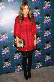 Dani Stahl chose a lace-embellished red Dolce & Gabbana dress for the 'Spark & Light' screening.