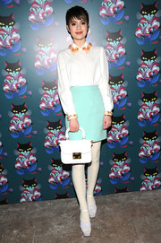 Sami Gayle teamed her blouse with a turquoise mini skirt for a bit of a retro vibe.