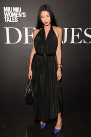 Lily Kwong looked alluring in a black halter dress during the 'De Djess' screening.