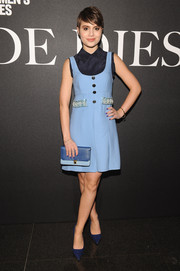 Sami Gayle went for retro cuteness in a blue Miu Miu mini dress layered over a collared blouse during the 'De Djess' screening.